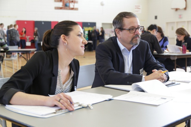 """Nicole Marion and Daniel Drolet judged essays in the Junior French division last year. """"I was mostly impressed with the students' enthusiasm and engagement,"""" said Mr. Drolet. """"They were all articulate, and did not hesitate to respond to questions. Not once did anyone respond with 'I don't know.' It was also obvious they had learned things — and that their interest had been sparked. It was delightful to see that."""""""